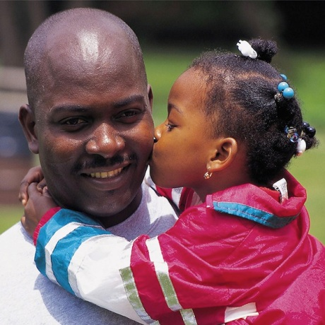 African American Girl Kissing Her Father